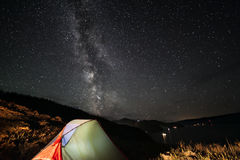 Milky way above tent at night. Royalty Free Stock Photography