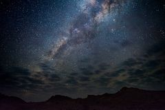 Milky Way arch, stars in the sky, the Namib desert in Namibia, Africa. Some scenic clouds. Milky Way arch, stars in the sky, the Namib desert in Namibia, Africa Royalty Free Stock Photography