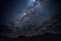 Milky Way arch, stars in the sky, the Namib desert in Namibia, Africa. Some scenic clouds. Milky Way arch, stars in the sky, the Namib desert in Namibia, Africa Royalty Free Stock Images