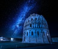 Milky way and baptistery in Pisa at night, Italy Royalty Free Stock Photo