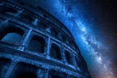 Milky way and Colosseum at night in Rome, Italy royalty free stock photography