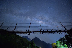 The milky way crossing the bridge. Long exposure milky way crossing the bridge at Mount Kinabalu in the back Royalty Free Stock Photos