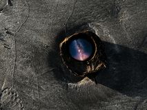 Milky way edit in a coconut shell on a sandy beach stock photo