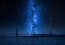 Milky way and falling stars over bay in Queensferry, Scotland royalty free stock photography