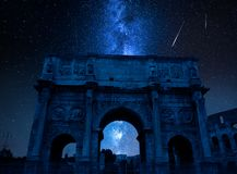 Milky way with falling stars over Triumphal arch, Rome, Italy stock photo
