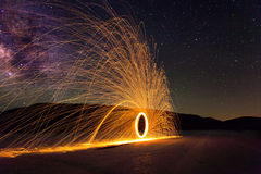 Milky Way with Fire and showering sparks. Milky Way over the Nevada Desert with fire and sparks from spinning steel wool Stock Images