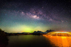 Milky way with fireworks Stock Image