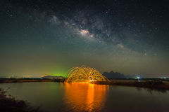 Milky way with fireworks Stock Photo