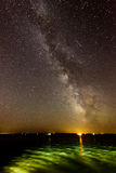 Milky Way. With flashes of light in bay Royalty Free Stock Image