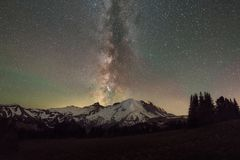 Milky Way Galaxy behind Mount Rainier. Beautiful starry sky and milky way galaxy behind Mount Rainier in Washington State Stock Photography