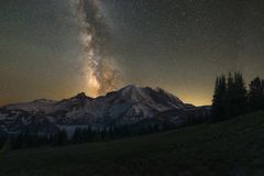 Milky Way Galaxy behind Mount Rainier. Beautiful starry sky and milky way galaxy behind Mount Rainier in Washington State Royalty Free Stock Photography