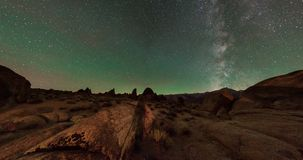 Milky way shot above the Boot arch in Alabama Hills Lone Pine, California. Milky way galaxy with green airglow during new moon in California Royalty Free Stock Photo