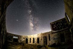 Milky Way galaxy over the runs of the Buckman Springs lithia water bottling plant. The Milky Way shines in the night sky over the ruins of the Buckman Springs royalty free stock photos