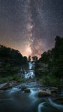 Milky Way Galaxy over a waterfall Royalty Free Stock Photography
