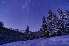 Milky Way Galaxy. Purple night sky stars above mountains Royalty Free Stock Photos