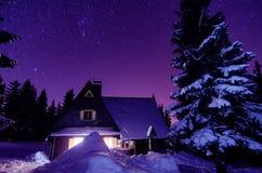 Milky Way Galaxy. Purple night sky stars above mountains Royalty Free Stock Image