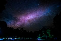 Milky way galaxy rising over the trees. In the national park forest, Night Landscapes stock image
