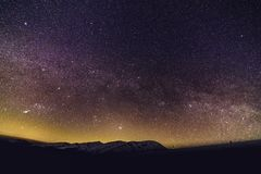 The Milky Way Galaxy and stars in the beautiful night sky. With Mountains royalty free stock images