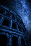 Milky way and great Colosseum at night in Rome, Italy. Europe Royalty Free Stock Photo