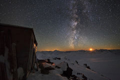 Milky Way and a house in the mountains Stock Photo