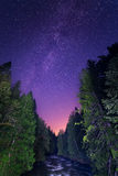 Milky Way With Lit Trees and River Stock Photo