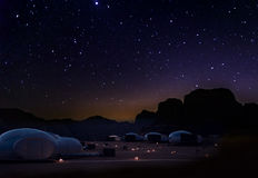 Milky Way and a lot of stars over the mountain at Wadi Rum desert. Sky at night and silhouette of mountain with wonderful landscape in summer, concept for Royalty Free Stock Image