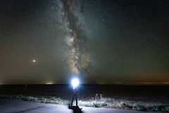 Milky way, the Mars planet and billions of stars in the night sky. royalty free stock image