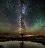 Milky way meets the northern lights royalty free stock image