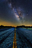 Milky way middle of the road Stock Photo