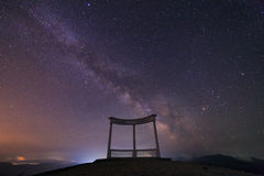 Milky Way and a monument on the mountain Royalty Free Stock Images