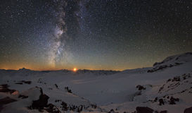 Milky Way and the moon mountains Royalty Free Stock Image