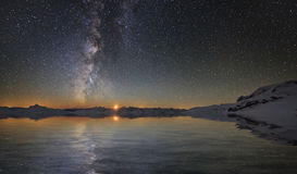Milky Way and the moon. Over the sea Royalty Free Stock Photo