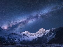 Milky Way and mountains in Nepal. Milky Way and mountains. Amazing scene with himalayan mountains and starry sky at night in Nepal. Rocks with snowy peak and sky Royalty Free Stock Photo