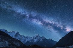 Milky Way and mountains in Nepal. Milky Way and mountains. Amazing scene with himalayan mountains and starry sky at night in Nepal. Rocks with snowy peak and sky Royalty Free Stock Image