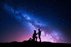 Milky Way. Night landscape with silhouettes of a couple Royalty Free Stock Photos