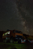 Milky Way in the night sky above the KAMAZ and tourist campground. Brookvalley Spokoyny at the foot of outer north Stock Photos