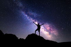 Milky Way. Night sky and silhouette of a man. Milky Way. Night sky with stars and silhouette of a man with raised-up arms royalty free stock image