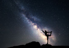 Milky Way. Night sky and silhouette of a sporty woman Royalty Free Stock Images