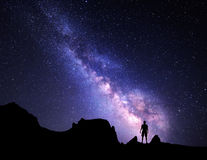 Milky Way. Night sky and silhouette of a standing man Stock Photos