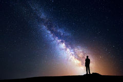Milky Way. Night sky and silhouette of a standing man Royalty Free Stock Photography