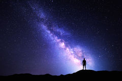 Milky Way. Night sky and silhouette of a standing man royalty free stock image