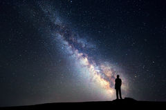 Milky Way. Night sky and silhouette of a standing man Royalty Free Stock Images