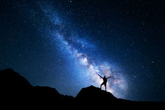Milky Way. Night sky and silhouette of a standing man Stock Image