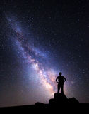 Milky Way. Night sky with stars and silhouette of a man.  stock images
