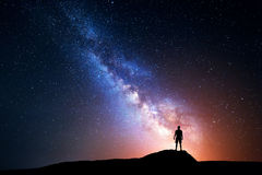 Milky Way. Night sky with stars and silhouette of a man. Milky Way. Night sky with stars and silhouette of a standing happy man with yellow light. Space royalty free stock photos