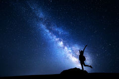 Milky Way. Night sky with stars and silhouette of a woman Royalty Free Stock Images