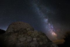 Milky way on nuraghe La Prisgiona. A nitght view of milkyway over Nuraghe La Prisgiona stock image