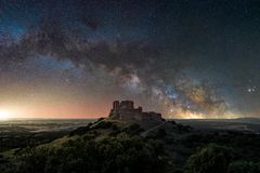 Milky way on the old hill stock photo