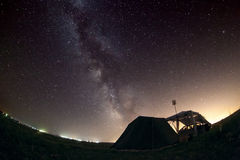 Milky Way stars. Our home galaxy over the camp Stock Photos