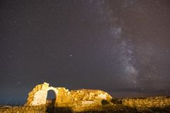 Milky way over the ancien ruin door entrance for a space dimension stock images